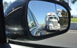Truck In Rear View Mirror