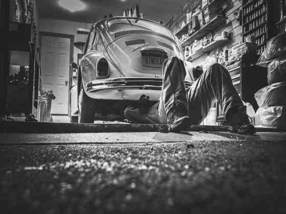 man working on an older volkswagen