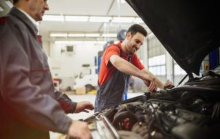 Technician working on a car - Sparks Auto Care