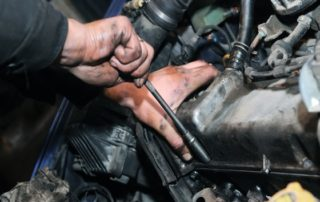 Waynes Technician Working On A PCV Valve