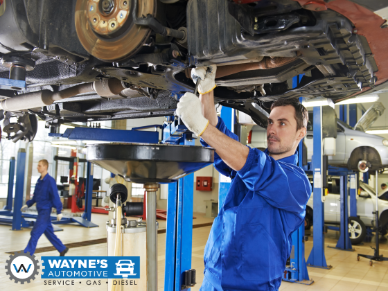 Service Technician Working On Car At Wayne's Automotive Center